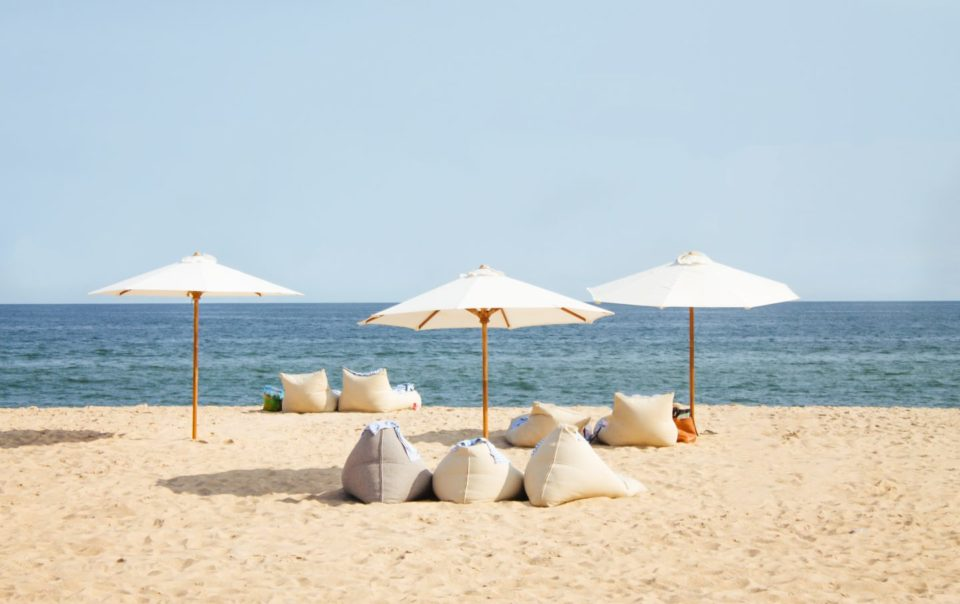 Umbrellas and bean bags on the beach
