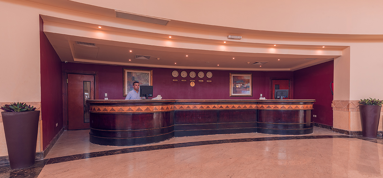 Receptionist at the hotel reception counter