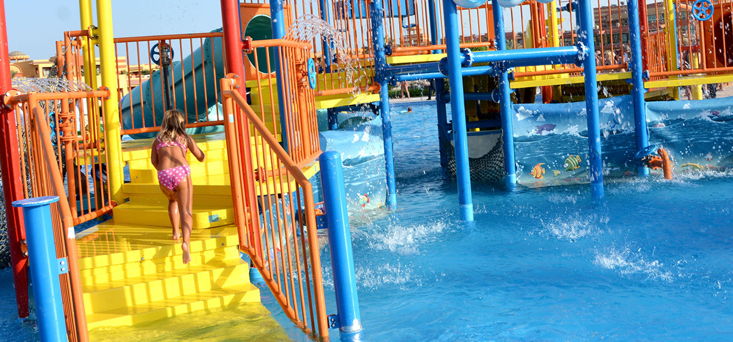 Child going up the stairs of water slide