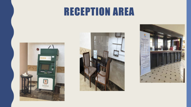 Seating space and reception with a poster about COVID-19 safety measures